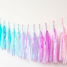 Studio Mucci: Iridescent Mermaid Rainbow Tassel Garland.| Handmade.| Designed by me.| Perfect condition.| Price includes US shipping.| 1 garland is approx. 10ft long & each tassels hangs at about 13 inches.| Pastel and special iridescent accent.| made of tissue paper.| Original selling price $45. I #tasselgarland #homedecor #pastel #iridescent #rainbow #unicorn #spring #holographic #studiomucci #handmade #decor #pastelrainbow #kawaii #frill #party #partydecor #gift #garland #princess #art…