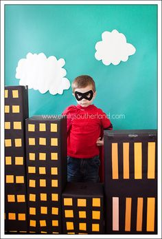 Superhero party pictures. Every child dresses up and take pictures behind the city. Such a great idea.