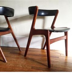 Set of six walnut curved back dining chairs designed by Kai Kristiansen. Original black vinyl upholstery is in perfect condition. Chairs are in