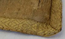 16th century silk brocade with what appears to be tabletwoven trim