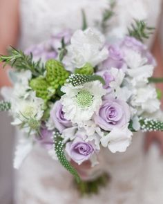 soft lilac bouquet with white scabiosa (pin cushion flower).  It's what got me interested in gardening.  #purple #wedding #bridal