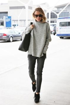 Le-Fashion-Blog-Blogger-Anine-Bing-Airport-Style--Round-Sunglasses-Comfortable-Turtleneck-Sweater-Cropped-Skinny-Jeans-Croc-Tote-Fringe-Booties-Via-Anines-World (1)