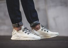 The adidas ZX Flux ADV is back with a simple Off-White colorway that uses Yeezy 350 Boost laces for a premium take on the instant-classic lifestyle model