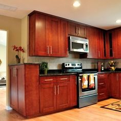 Cherry Kitchen Cabinets Black Granite cherry wood kitchen cabinets with silver appliances | new home
