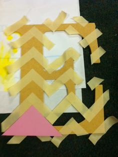 The EASIEST way to paint chevron! Just cut a corner off of a piece of paper and use that as a guide!
