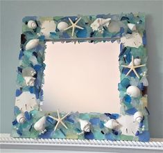 Beach decor sea glass and seashell mirror. My nautical decor beach glass and shell mirror is made with white seashells, sea glass in your choice of colors, sand dollars, pearls, starfish, and optional pearls....perfect for beach house decor or a beach wedding gift. 18x18 overall with a 12x12 mirror