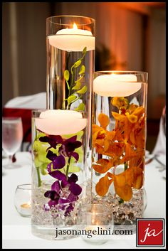Tropical and fall-inspired centerpieces. Flowers and candles. A beach wedding reception at TradeWinds Island Resorts, St. Pete Beach. October 2014.