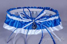 I remember you saying once that the garter should have something groom-related......think Dave would dig this ;)  (ON SALE Custom Toronto Maple Leafs Wedding by sugarplumgarters, $28.79)