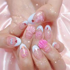 Cute pastel nails polish with fake neon words & shells