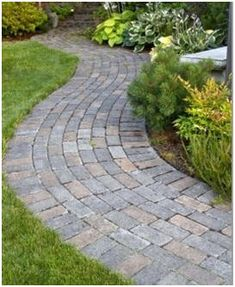 14 Free DIY Landscape Walk and Garden Path Building Guides - Create your own, in brick, stone or concrete with the help of these free, step-by-step guides.