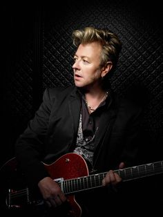 Brian Setzer.  A tip of the hat really should be given to Brian Setzer.  He is not simply the Stray Cats.  His Brian Setzer Orchestra tears it up.  This is not your grandpa's swing...it's nitrous infused!