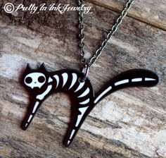 Dead Kitty Cat Skeleton Necklace. $15.95, via Etsy.