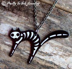 Dead Kitty Cat Skeleton Necklace. $15.95, via Etsy.