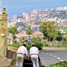 """Carros de cesto do Monte, Funchal   The basket cars Mount is the name given to a means of transportation on the island of Madeira in Funchal , a descent of the mount to Livramento where it runs two kilometers in ten minutes in a wicker basket drive mounted on wooden skids down across a road called the Train Path. It is a means of transport only two or three places moved by the feet of two men, known as """" Carreiros """" . The length is 10m , reaching a maximum 80 km / h , a distance of 2 km"""