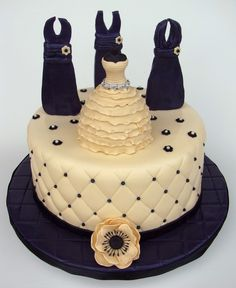 This was a fun cake to do for a good friend.  Cake is a 10 round Kahlua cake with a Kahlua cream cheese filling and covered in ivory MMF.  Bridesmaids dress silhouettes are a deep purple and made from a fondant/tylose mixture with skews stuck in them to make them stand up.  Wedding dress is made from a mini wonder mold and covered in fondant and accented with rhinestone ribbon I found at JoAnns.  All the dresses were made to look like the wedding/party dresses. TFL