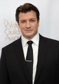 Photo of 2013 Writers Guild Awards for fans of Nathan Fillion. LOS ANGELES, CA - FEBRUARY 17
