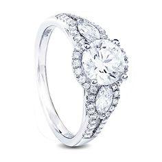 White gold diamond engagement ring round centre diamond and marquise shape diamonds