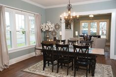 Sometimes all a room needs are new hardwood floors, fresh paint and a pretty chandelier, as Joanna did for this dining room.