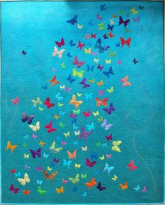 Butterfly appliqué quilt, just beautiful free motion on this quilt.