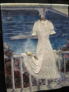 A great possibility for storing/displaying wedding dress.  Maybe design the background using a honeymoon photo - beautiful!