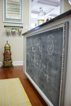 chalk board on the back of an island with framed in molding. Would do this if my kids were still small | Perfectly Imperfect Blog