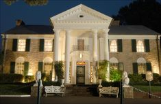 {*Graceland is a large mansion with a white-columned portico in estate in Memphis, Tennessee that was home to Elvis*}