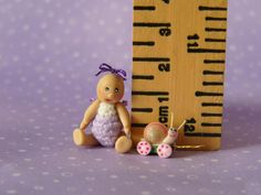 Micro Miniature OOAK Articulated Doll with a Pink Snail Pull Toy.  Omg the snail it to die for cute!