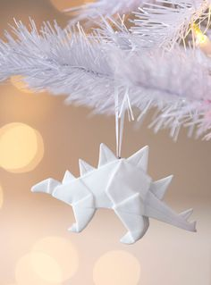 An origami-inspired ornament in the shape of dinosaurs is just whimsical enough—and just geometric enough—to capture our design hearts.