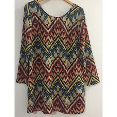 NWT Forever 21 Multi-colored Shift Dress Fun and light shift dress from Forever 21. New with tags. A kaleidoscope of color! Long sleeves. Zipper at back. 100% polyester. Size Medium. Forever 21 Dresses