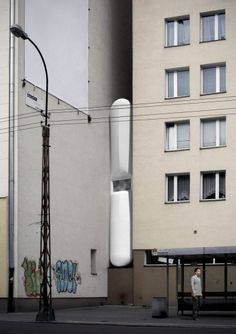In Warsaw, Poland in the district of Wola lies a small crack of space between the buildings on 22 Chłodna Street and 74 Żelazna Street