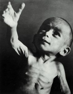 Greece, winter of 1941-1942. Starving Greek child. In the autumn of 1941 German occupation forces confiscated all produce to answer food needs of their troops on the Soviet front. An estimated number of half a million people lost their lives of starvation in that most cold winter of 1941-1942, mostly at the urban areas. Twice a day special servicemen collected dead frozen bodies to give them a hasty collective burial.