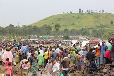 Displaced people line up for an emergency distribution at a camp outside Goma in Congo this week. The distribution was a 4-day, multiagency effort, of which the IRC was a lead partner.