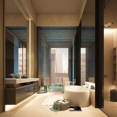 A gorgeous high-ceilinged penthouse bathroom in NYC. Love the recessed lighting, modern furnishings and overall masculine feel.
