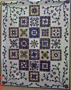 Like the look of this sampler quilt, nice soothing colors!  Douces couleurs!