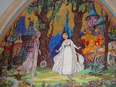 The five beautiful mosaics inside Cinderella Castle's archway, tell the story of Cinderella.  The murals