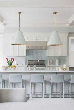 Light blue chevron tile backsplash in a modern costal kitchen.