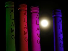 A hazy supermoon shines behind the lighted smokestacks at the Alamo Quarry Market, formerly a cement factory, on June 22 in San Antonio, Texas.