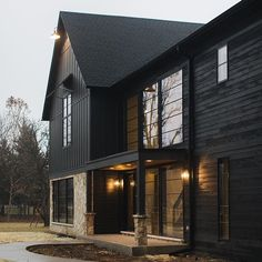 Defining Built & designed by is James Hardie in Sherwin Williams Iron Ore. Defining Built & designed by is James Hardie in Sherwin Williams Iron Ore. Black House Exterior, Exterior House Colors, Exterior Design, Siding Colors, Loft Interior, Black Barn, Black Wood, Dark House, Modern Farmhouse Exterior