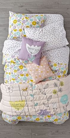 Shop Floral Suite Bedding.  Adorned with soft, stylish flowers, this floral bedding set will instantly freshen up any kids room.  The appliqued quilt reverses to solid pink, making it like two quilts in one.