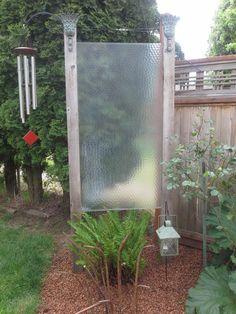 Updated photo of my repurposed shower door into a garden screen.