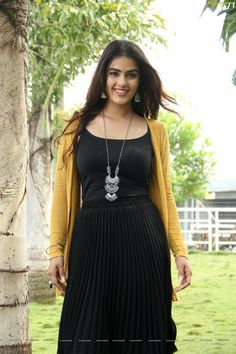 Check out beautiful pictures of the charismatic beauty Kavya Thapar wearing Black Strappy pleated dress and long jacket Beautiful Indian Actress, Beautiful Actresses, Beauty Full Girl, Long Jackets, Wearing Black, Indian Beauty, Indian Actresses, Hot Girls, Beautiful Pictures