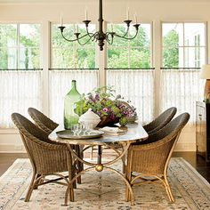 Sheer cafe curtains, hung just above the bottom sash, give softness and privacy while still allowing a view of the outside and inviting lots of sunlight to stream in through the upper panes.