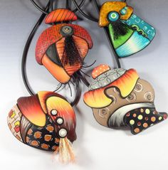 love this mixed media approach but I couldn't wear a necklace with feathers...I'd itch the whole time!