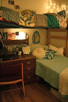 I love that beautiful old desk (and totally wish that mine will look like that! Well, I can hope) and the layout of these beds. Plus, blue is totally in my color scheme, so its nice to see different shades of it implemented so well in a dorm room.