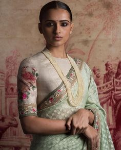 Raw silk blouse in ivory with embroidery and a pale sea green pastel hued saree with self pattern from - Of August 2016 Sari Blouse Designs, Saree Blouse Patterns, Ethnic Fashion, Indian Fashion, Indian Dresses, Indian Outfits, Elegant Saree, Indian Attire, Indian Wear