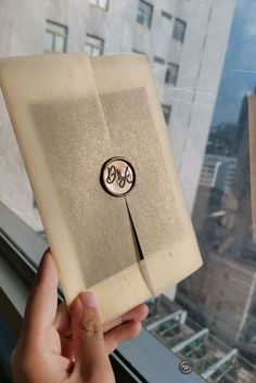 Vellum wedding invitation suite features vellum wrap and custom wax seal sticker.