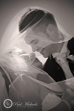 Veil flying during kiss at Ohariu farm wedding.  #Wedding #photographers, #Wellington, New Zealand. http://www.paulmichaels.co.nz/