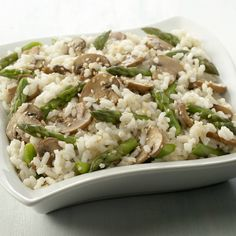 This quick and easy twist on risotto is tossed with asparagus and mushrooms and toasted sesame seeds.