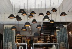 Genius idea: Using bowler hats as shades for light fixtures great-ideas-for-retail-business