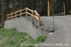 This timber wall was built to support and stabilize the asphalt driveway…